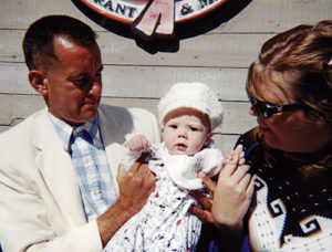 Steve Weber (Forrest Gump Impersonator) holds a cute baby at San Francisco's Pier 39