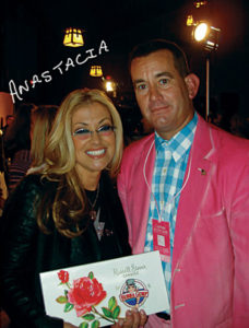 Steve Weber (Forrest Gump lookalike wearing pink suit) meets singer Anastacia at Breast Cancer fundraiser in Minneapolis, MN
