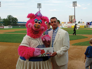 Steve Weber (Forrest Gump lookalike) meets St. Paul Saints mascot 'Mudonna' at ballpark in Minnesota.