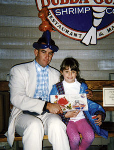 Steve Weber (Forrest Gump impersonator) meets a girl on San Francisco's Pier 39 Bubba Gump restaurant who lets Steve wear her balloon hat.