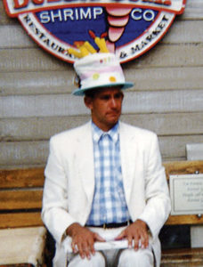 Steve Weber (Forrest Gump lookalike) wears a Birthday candle hat at Bubba Gump restaurant in San Francisco, CO