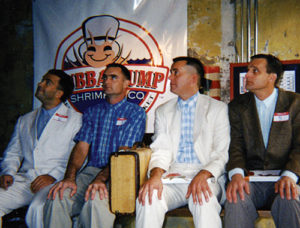 Steve sits with other Forrest Gumps at a lookalike contest