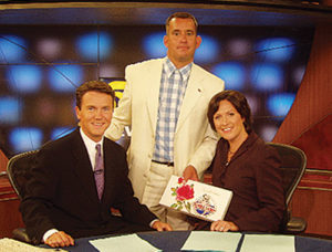 Steve (as Forrest Gump) poses with the TV anchors