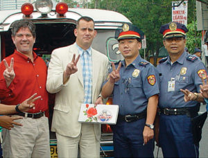 Steve creatively engages with policeman from the Philippines