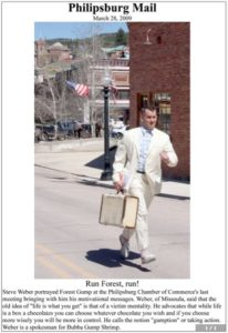 Philipsburg Mail photo of Steve Weber running as Forrest Gump after speaking to Chamber Members (March 28, 2009)