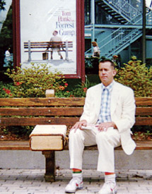 Steve sits on bench in front of Forrest Gump movie poster