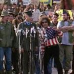 Abbie Hoffman encourages Forrest Gump to give a speech about Vietnam