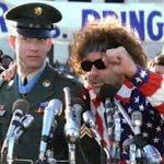 Abbie Hoffman congratulates Forrest on his moving speech and asks him his name