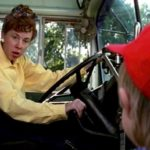Forrest, Jr. gets ready to board the bus with the same bus driver that drove Forrest to school when he was a boy