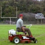 Forrest mows the lawn on the Greenbow, AL football field
