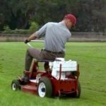 Forrest cuts the lawn at the Greenbow, Alabama high school football field - for free!