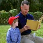 Forrest and Forrest, Jr. look at the book Curious George