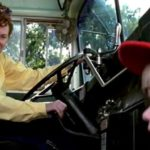 Forrest, Jr. gets a smile from the bus driver Dorothy Harris