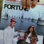 Forrest shows the woman on the bench the Fortune magazine with Lt. Dan on the cover